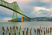 Rain clouds at Megler Bridge in Astoria, Oregon.  The bridge spans the four mile width of the Columbia River, connecting Oregon and Washington States on the coastal highway 101.  The bridge first open