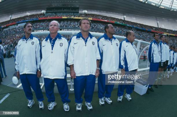 View of members of the Brazil national football team with manager Mario Zagallo pictured 2nd from left standing up for the anthems prior to the start...