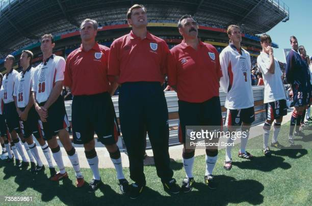 View of members of the England national football team with manager Glenn Hoddle pictured in centre standing for the anthems prior to the start of the...