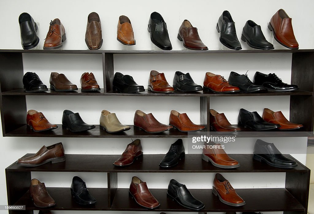 View of men shoes made with a hidden insole, to increase height, in a store in Mexico City on January 16, 2013.