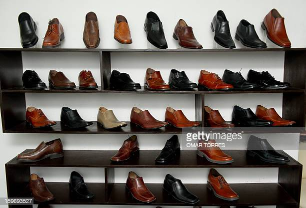 View of men shoes made with a hidden insole to increase height in a store in Mexico City on January 16 2013 AFP PHOTO/ OMAR TORRES