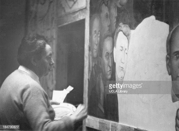 View of Mexican artist and painter Diego Rivera as he works on a large mural at the New Workers School New York New York 1930s