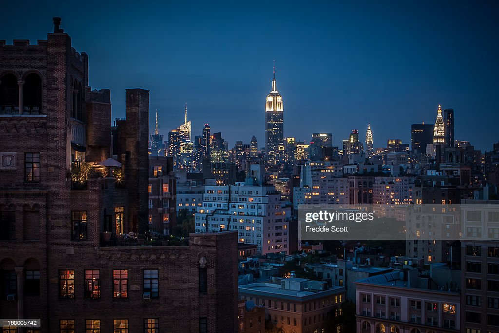 CONTENT] View of Midtown from the West Village. Empire State Building, Chrysler Building and other skyscrapers during sunset in New York City.