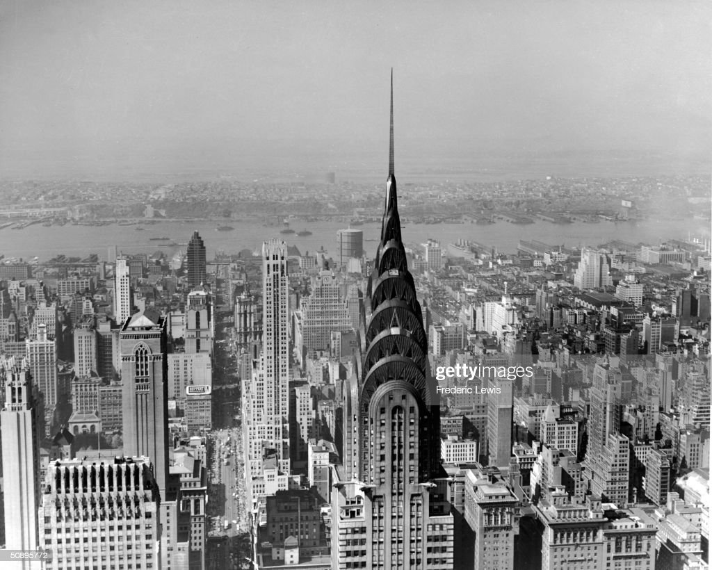 View of Midtown Manhattan looking west along 42nd Street with the Chrysler Building, in the center, New York, mid 20th Century. New Jersey is visible across the Hudson River in the background.