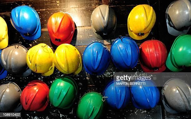 View of miners' safety helmets at the coal mine 'Chiflon del Diablo' in Lota 30 km south of Concepcion on February 07 2011 'Chiflon del Diablo' which...
