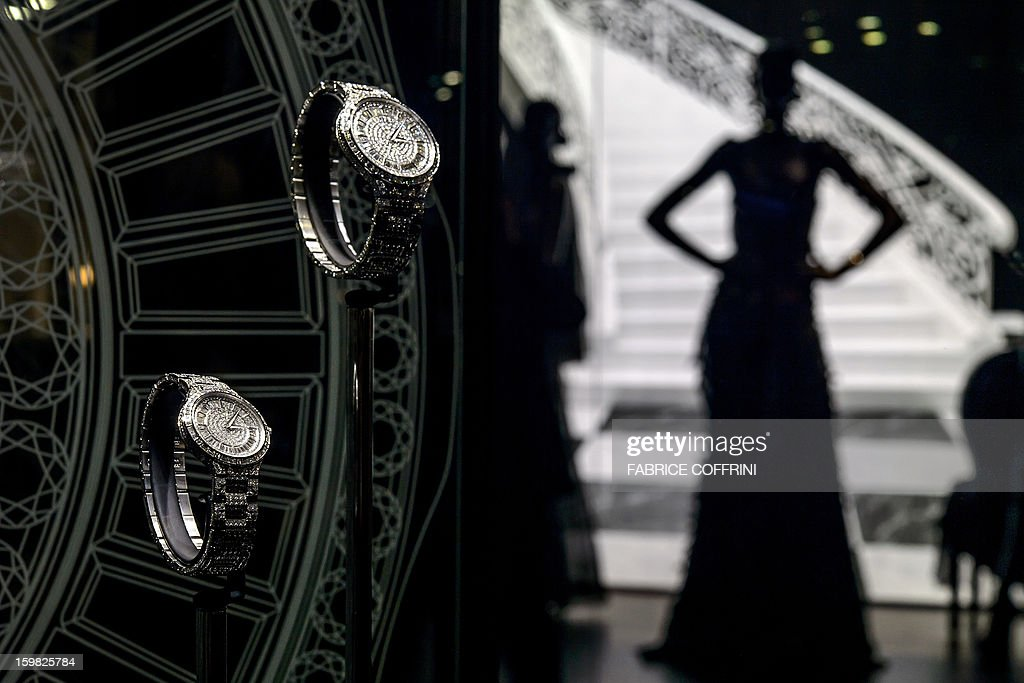 A view of models posing next to watches by watchmaker Piaget, part of luxury goods group Richemont, during the opening day of the 'Salon International de la Haute Horlogerie' (SIHH), a professional fair in fine watchmaking, on January 21, 2013, in Geneva. Swiss manufacturer of luxury goods Richemont announced that sales met expectations for the third quarter of its 2012 fiscal year at 2.8 billion Euros, up 5% from the preceding year at the constant exchange rate and 9% at the real exchange rate.