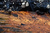 View of molasses in the waters of Las Canas river in Apopa 12 km north of San Salvador on June 2 2016 Molasses gushed into a river in El Salvador...