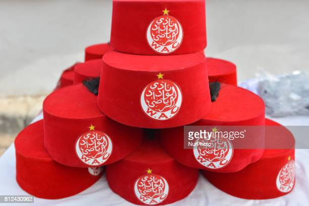 A view of Moroccan Fez Wydad Athletic Club Hats seen for sale inside Casablanca's medina On Friday June 30 in Casablanca Morocco