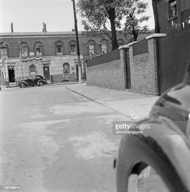 A view of Morpeth Street in London's East End decorated for a party to celebrate the coronation of Queen Elizabeth II 2nd June 1953 Original...