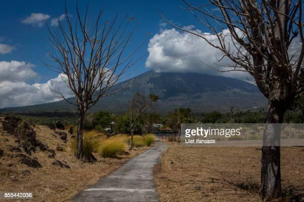 KARANGASEM BALI INDONESIA SEPTEMBER 29 A view of mount Agung from Kubu on September 29 2017 in Karangasem regency Island of Bali Indonesia Indonesian...