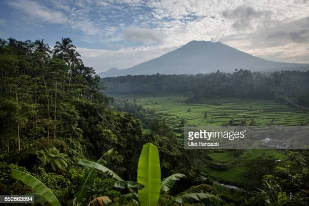 KARANGASEM BALI INDONESIA SEPTEMBER 24 A view of mount Agung on September 24 2017 in Karangasem regency Island of Bali Indonesia Indonesian...
