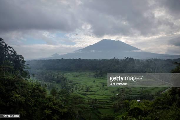 KARANGASEM BALI INDONESIA SEPTEMBER 24 A view of mount Agung on September 24 2017 in Karangasem regency Island of Bali Indonesia Indonesian...