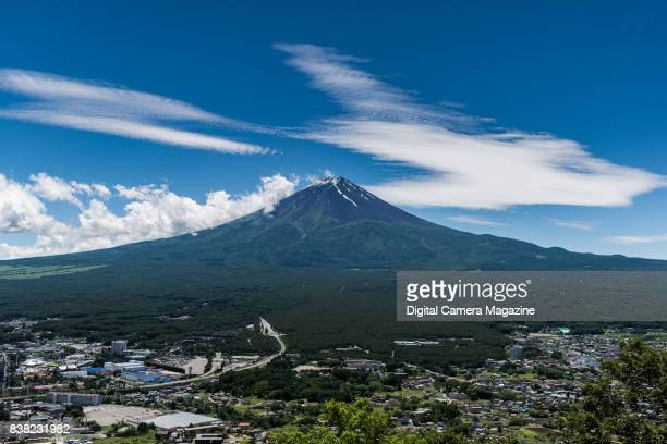 View of Mount Fuji in Japan photographed from the northeast with a standard 50mm lens taken on June 17 2016 The city of Fujiyoshida is visible in the...
