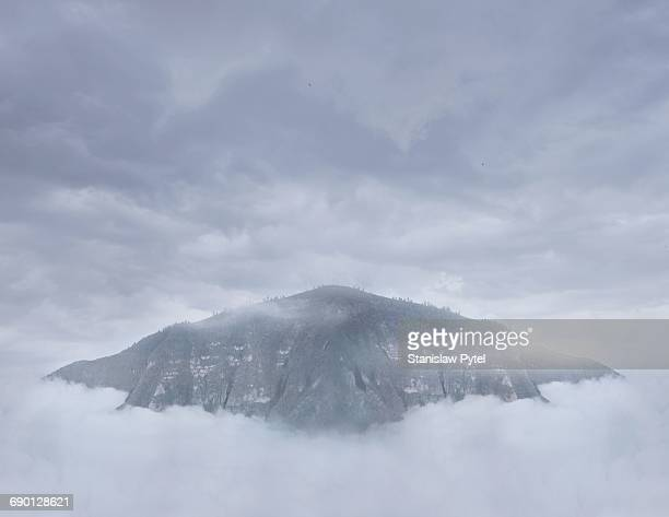 View of mountain immersed in clouds