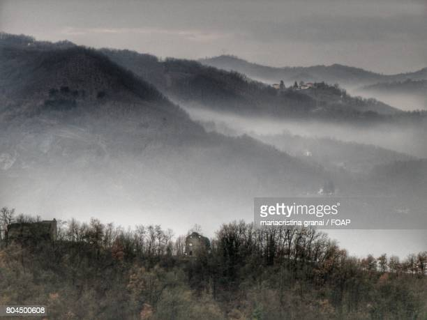 View of mountains in fog