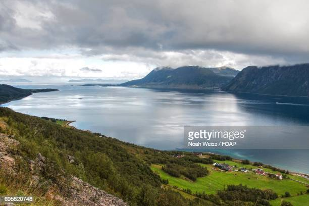 View of mountains with lake in Harstad, Norway