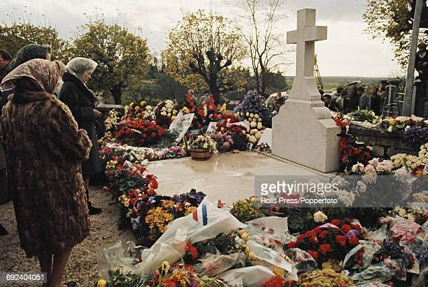 View of mourners standing in front of the flower strewn grave of President Charles de Gaulle in the cemetery at ColombeylesDeuxEglises in France on...