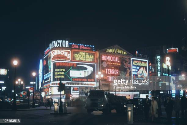 A view of neon signs in Piccadilly Circus London 1961 The London Pavillion cinema is showing the Fu Manchu film 'Terror of the Tongs'