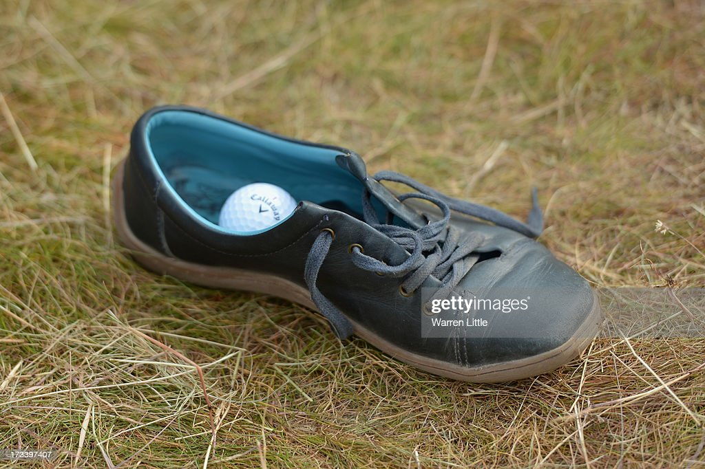 View of Niclas Fasth of Sweden's ball which landed in a Woman's shoe on the 18th hole during the third round of the Aberdeen Asset Management Scottish Open at Castle Stuart Golf Links on July 13, 2013 in Inverness, Scotland.
