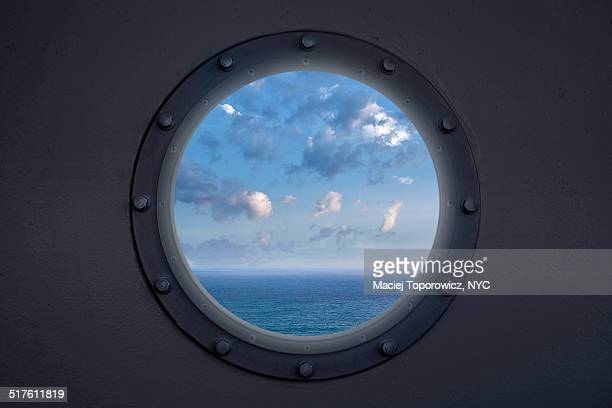 View of ocean through a porthole on the ship