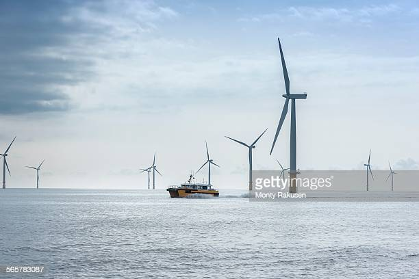 View of offshore windfarm and service boat