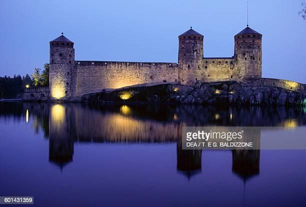View of Olavinlinna castle at night Savonlinna Finland 15th century