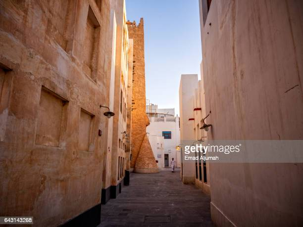 view of old tower at the end alleyway in Souq Waqif, Doha, Qatar - February 3, 2017