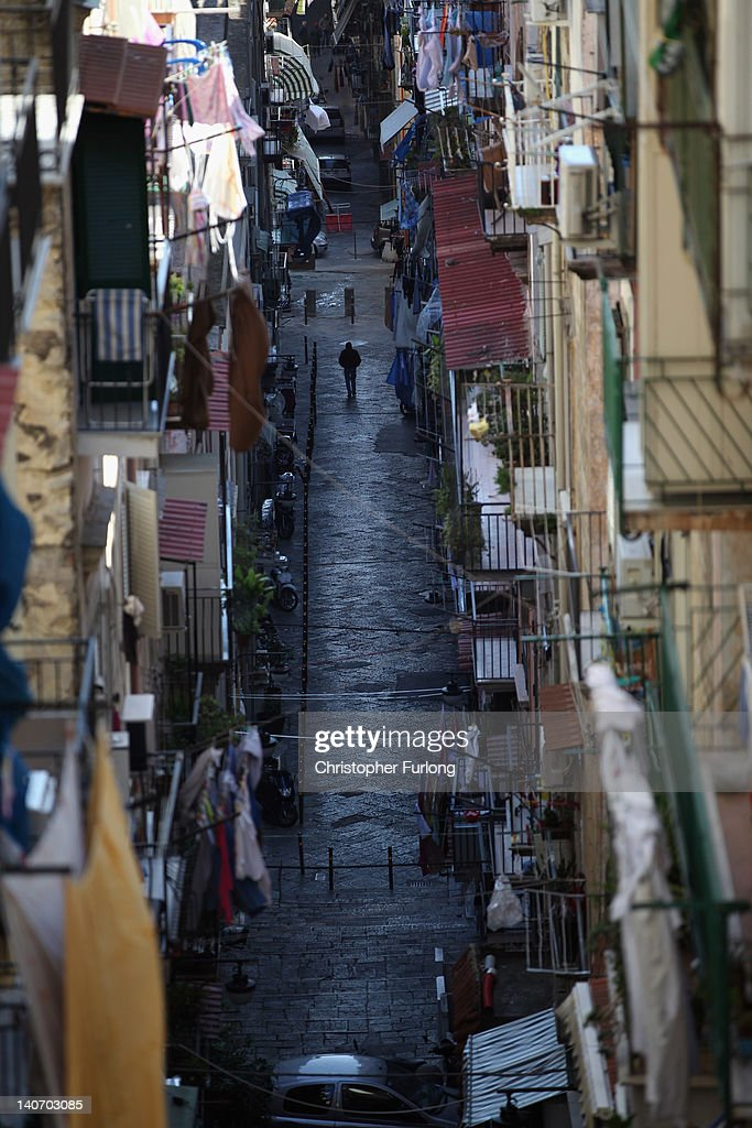 A view of one of the famous narrow streets of Naples on November 14, 2011 in Naples, Italy. Naples is famed for it's narrows streets, pizza, Mount Vesuvius and Unesco protected buildings.