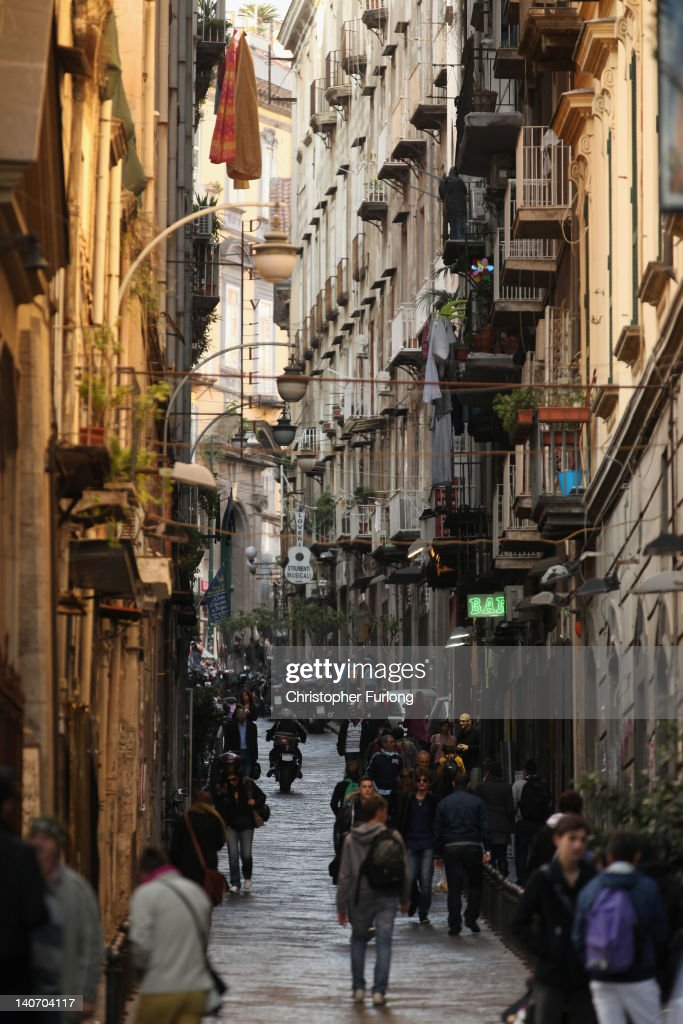 A view of one of the famous narrow streets of Naples on November 16, 2011 in Naples, Italy. Naples is famed for it's narrow streets, pizza, Mount Vesuvius and Unesco protected buildings.