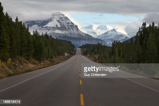 View of open road through rocky mountains