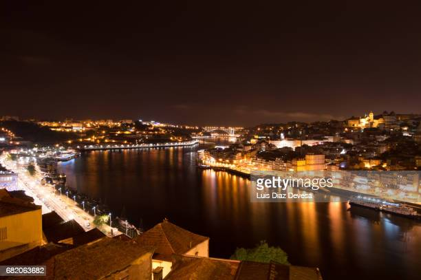 View of over Douro River and Old City at night, Porto (UNESCO World Heritage List, 1996), Norte, Portugal