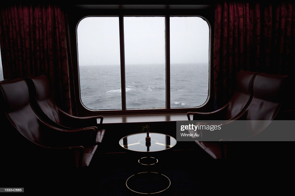 View of Pacific Ocean through the window of lounge area on a passenger ship : Stock Photo