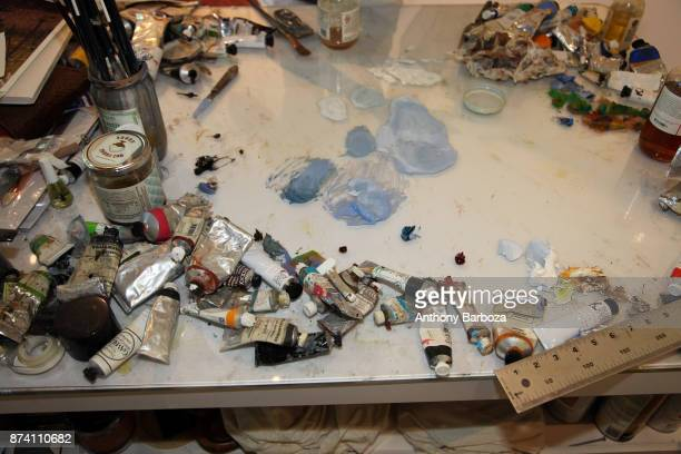 View of paints on a table in artist April Gornik's studio Sag Harbor New York 2011