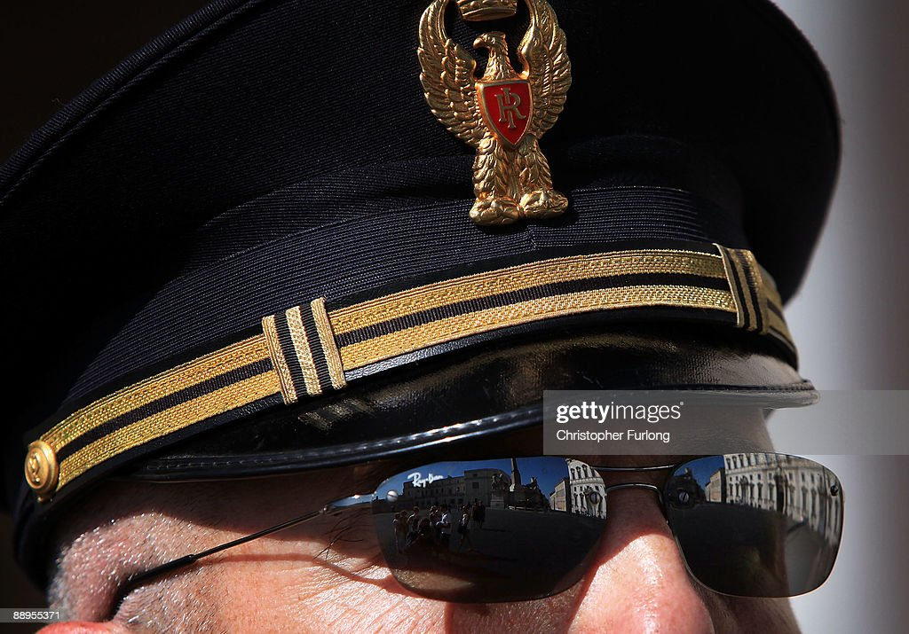 A view of Palazzo Del Quirinale is reflected in the Rayban sunglasses of a state policeman on July 9, 2009 in Rome, Italy. With nearly 3000 years of history Rome continues to live up to its motto of The Eternal City being one of the founding cities of Western Civilisation.