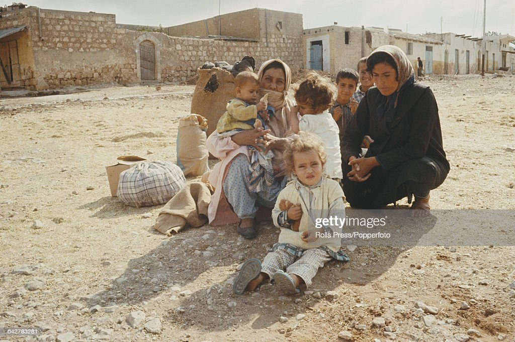 View of Palestinian Arab women and children sitting and crouching inside the Jabalia refugee camp in the Gaza Strip territory on 25th April 1969