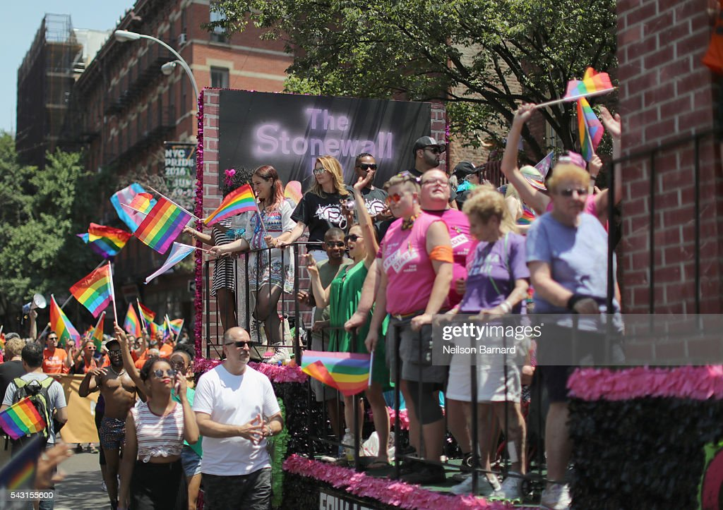 A view of parade watchers near the historic Stonewall Inn during the New York City Pride 2016 march on June 26, 2016 in New York City.