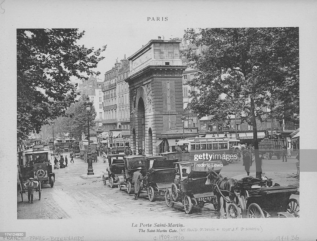 A view of Paris a row of horsedrawn cabs wait near the SaintMartin Gate at Boulevard St Denis France circa 19091910 Photo by