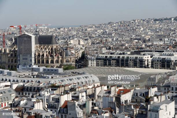 A view of Paris with the SaintEustache church and 'La Canopee' a curvilinear building designed by French architects Jacques Anziutti and Patrick...