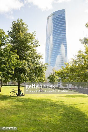 View of park and office skyscraper, Bilbao, Spain