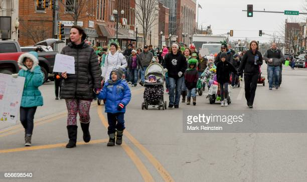 View of participants as they march in the annual Saint Patrick's Day Parade Emporia Kansas March 11 2017