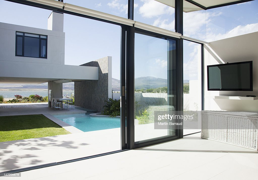 View of patio and swimming pool through sliding doors of modern house & Sliding Door Stock Photos and Pictures | Getty Images Pezcame.Com