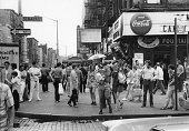 View of pedestrian traffic on the south west corner of 2nd Avenue and St Parks Place New York New York August 2 1969 On the corner is Gems Spa and...