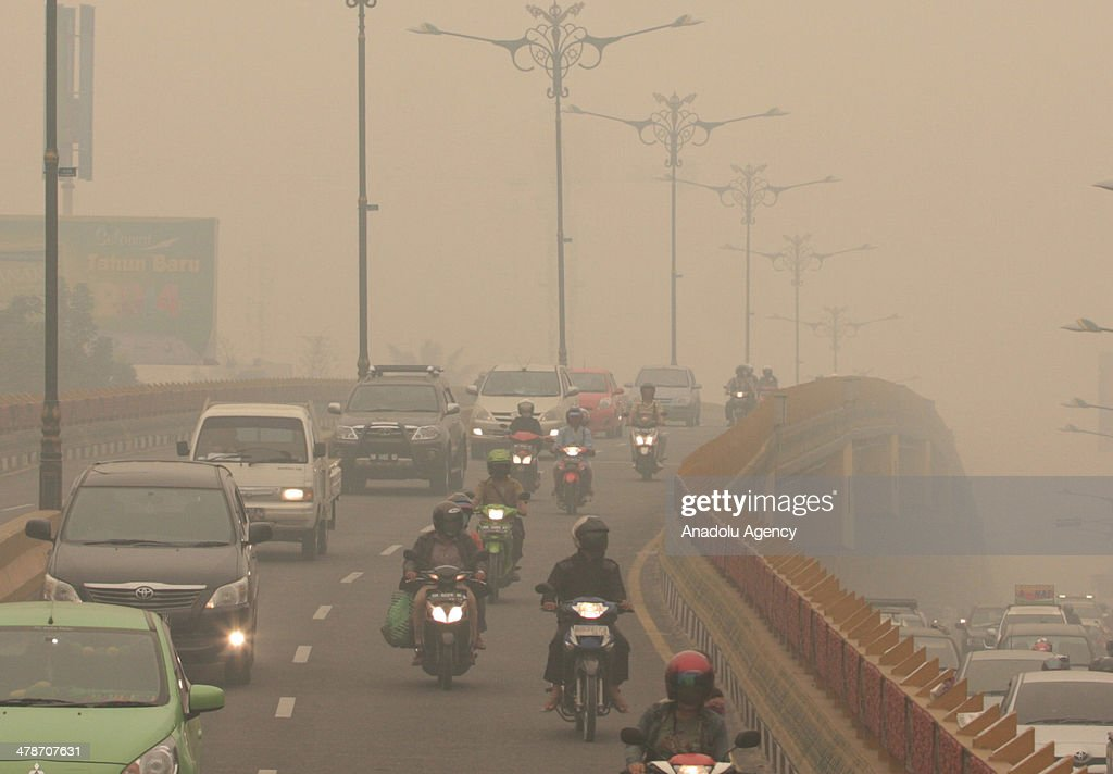 A view of Pekanbaru city's polluted air caused the haze due to the forests fire on March 14, 2014 in Pekanbaru, Riau, Indonesia. Smoke haze from forest fires that still covered the Riau province causing many schools were closed and sick people breathing.