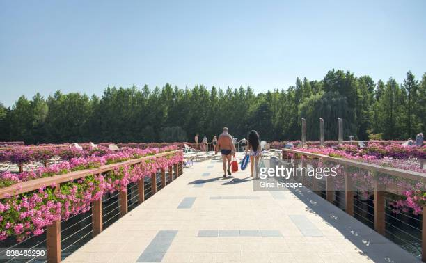 View of people in swimsuit on the terrace of Lake Heviz, Hungary.