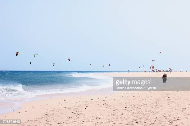 View Of People Kite Surfing On Beach
