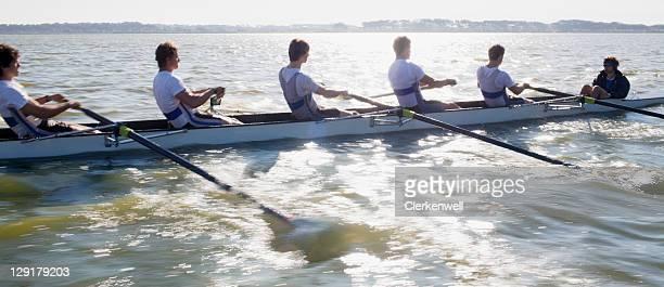 View of people oaring canoe