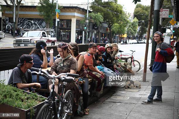 View of people on a bench on Haight Street near the intersection with Masonic Avenue in the HaightAshbury district San Francisco California July 17...