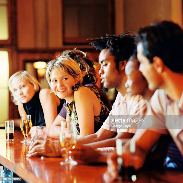 view of people sitting at a bar counter with drinks