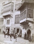 View of people two on donkeys on a street Cairo Egypt circa 1881 The photo was originally titled 'The Street Which is Called Straight'