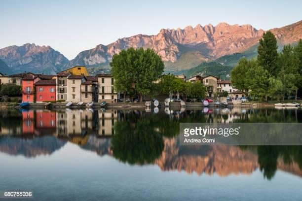 View of Pescarenico, fisherman village. Resegone mountain in the background. Pescarenico, Lecco, lake Como, Lombardy.